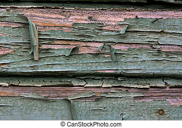 flaked paint - old, exfoliated color in a wooden box....