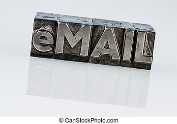 written email in lead letters - the word e-mail in lead...