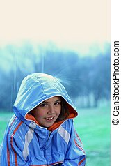 Young girl in the rain - Young cute girl in the rain with...