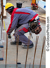 construction workers at a construction site - construction...