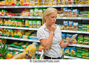 selection in a supermarket - a woman is unable to cope with...