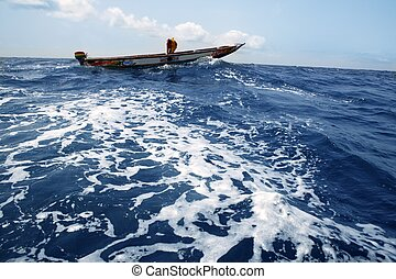 African motorboat in atlantic blue water