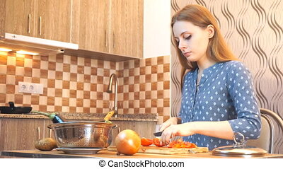 Healthy food lifestyle: beautiful woman casually cooking,...