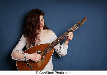 woman playing lute instrument - young woman playing old...