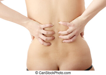 Back pain - Nude woman from behind Back pain concept...
