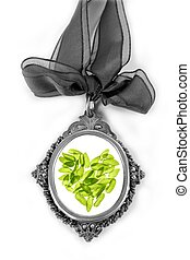 Cameo silver locket with green basil leaves heart isolated...
