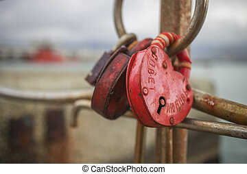 Symbol of love, heart-shaped lock chained on a pier in...