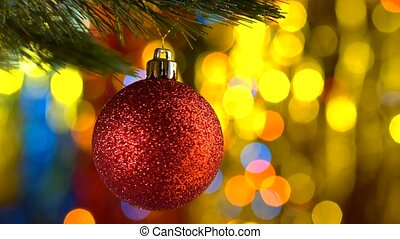Christmas ball rotates at the background of blurred lights -...