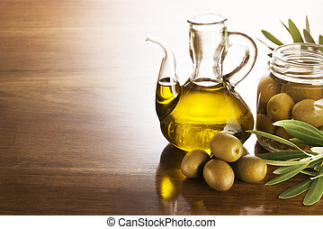 Olive oil and olives on a wooden table