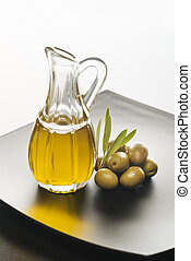 Olive oil - Glass bottle of premium virgin olive oil and...