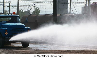 Truck Spraying Water Driving At Railway Station - In the...