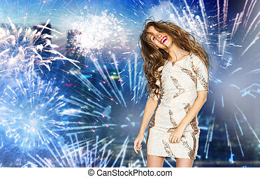 happy young woman dancing over firework at city - people,...