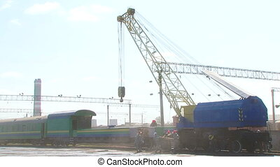Railway Workmen Loading Wagon With Big Crane At Station -...