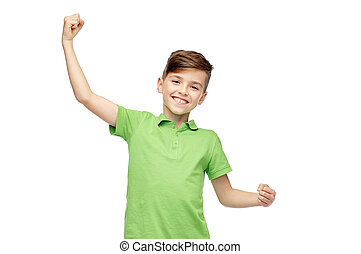happy boy in polo t-shirt showing strong fists - childhood,...