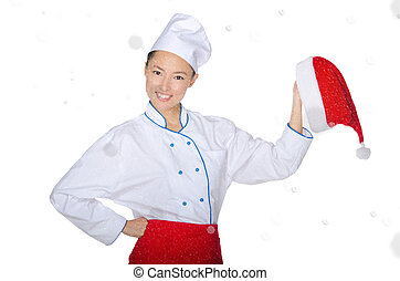 Happy asian chef with christmas cap in snow isolated on...