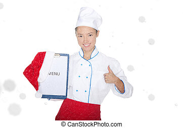 smiling asian chef with christmas menu and cap in snow...