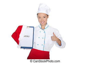 Happy asian chef with christmas menu and cap isolated on...