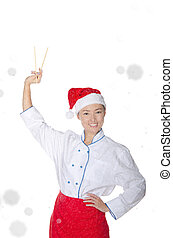 pleased asian chef in christmas outfit with chopsticks under...
