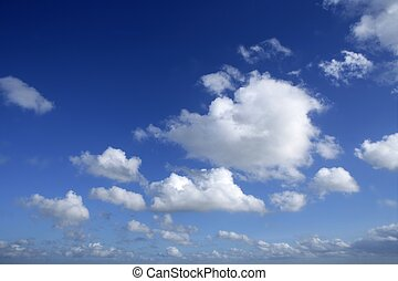 Blue beautiful sky with white clouds  in sunny day