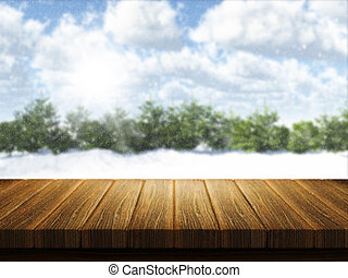Wooden table with Christmas snowy landscape defocussed in the background