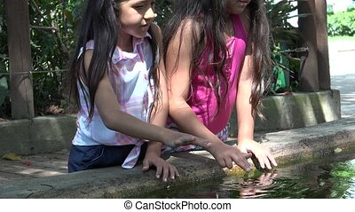Children Playing in Fish Pond