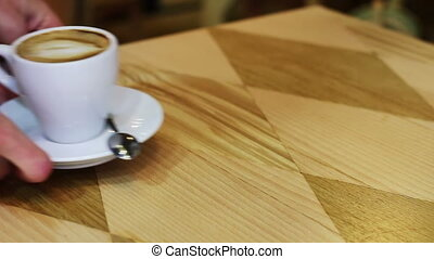 Coffee cup on wooden table. - White cup of coffee with foam...