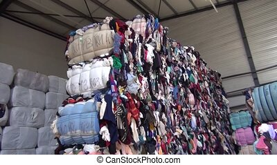 Recycling and sorting of textiles warehouse old clothes....