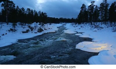 Winter River Flowing - Fast river flowing in the nordic...