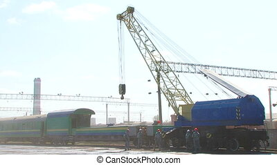 Workmen Loading Wagon With Crane At Railway Station