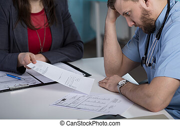 Legal consequences of medical error - Photo of doctor and...
