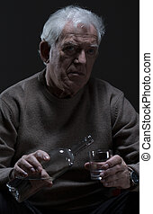 Old man drinking alcohol - Elder depressed man addicted to...