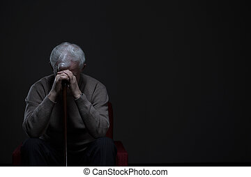 Elder man with depression - Depressed old man hiding his...