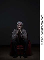 Old worried man with cane - Old man with worried face...