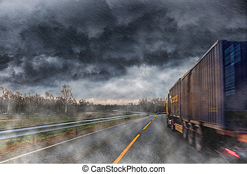Big lorry during the rain - Truck at road during a heavy...