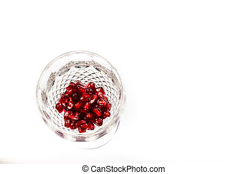 pomegranate  seeds in crystal glass
