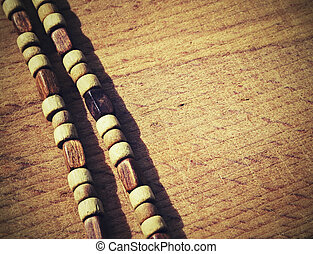 wooden beads on old boards