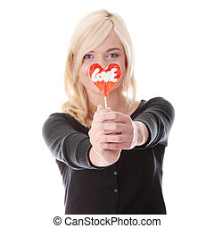 Teenage girl holding red heart shaped lollipop isolated