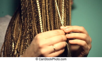 The process of braiding. It can be used in the training...