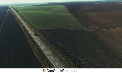 Aerial view of the road and a beautiful field of wheat Full...