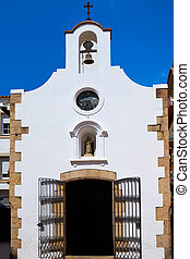 old whitewashed church in tossa de mar spain