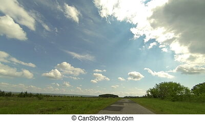Clouds over the road The path from Terenga village,...
