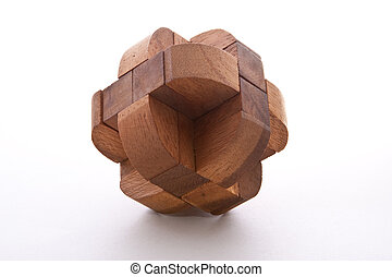 Wood Burr - Assembled wooden burr puzzle on white background