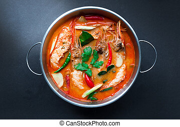 Tom Yum Goong,Thai Food in hot pot, top view on black...