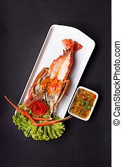 Grilled Giant River Prawn, top view on black background