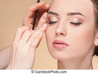 Experienced beautician is working at beauty salon - Close up...