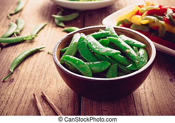 Peas salad on old wood background, Vegetarian food