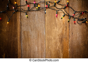 Top view, Christmas and New Year lights on old wood...