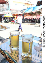 Hoi An Beer Stop - Two beers resting on a table streetside...