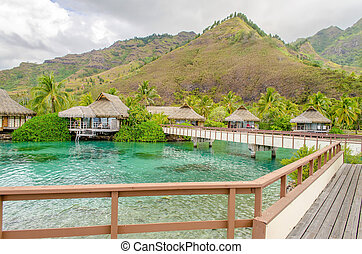Overwater Bungalows on a tropical paradise beach in French Polynesia