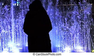 Silhouette people fountain light - Silhouette of people...